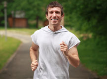Happy young male runner Stock Images