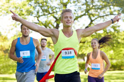 Happy young male runner winning on race finish Royalty Free Stock Photos
