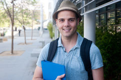 Happy young male student. On campus Stock Image