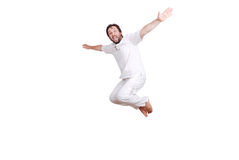 Happy young male in white clothes is jumping Royalty Free Stock Photography