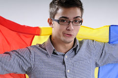 Happy young man. Showing romanian national flag Stock Photo
