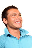 Happy young man. Closeup of a happy young man looking at camera royalty free stock photo