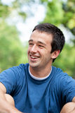 Happy young man. A happy young man outside royalty free stock photo