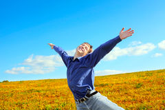 Happy Young Man. Raising his Hands in the Summer Field Royalty Free Stock Images
