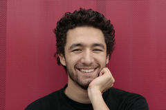 Happy young man. Young man with unshaved beard laughing Stock Photos