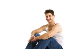 Happy Young Man. Handsome young brunette male smiling on a white background Stock Image