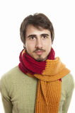 Happy young man. Portrait of joyful young man wearing scarf and green pullover against white background Royalty Free Stock Images