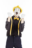 A happy young man, an actor, pantomime, rejoices in success. Stock Photos