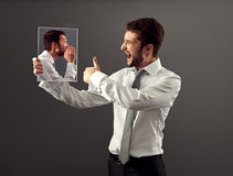 Young man agree with his inner voice stock photo
