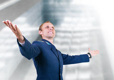 Happy young man aircraft pilot over glass modern building Stock Photo