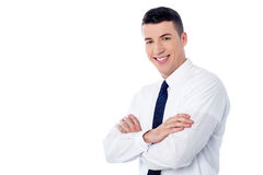 Happy young man with arms crossed Royalty Free Stock Photo