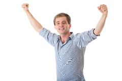 Happy young man with arms up in victory gesture Royalty Free Stock Images