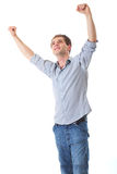 Happy young man with arms up in victory gesture Royalty Free Stock Photography