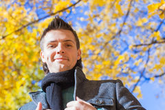 Happy young man in autumn park Stock Photo