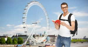 Happy young man with backpack and book travelling Royalty Free Stock Photos