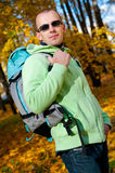 Happy young man with backpack in the park. Stock Photos