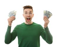 Happy young man with banknotes stock image
