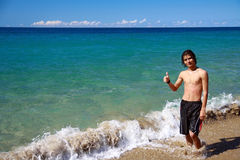Happy young man on beach Royalty Free Stock Photography