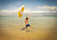 Happy young man at the beach Stock Photography