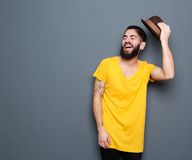 Happy young man with beard laughing Stock Photos