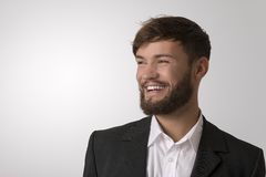 Happy young man with beard. Studio Shot royalty free stock photos