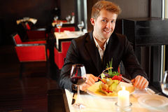 Man in black suit in a restaurant Stock Photo