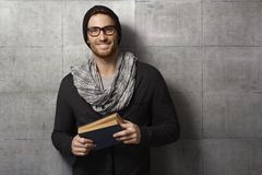 Happy young man with book stock photo