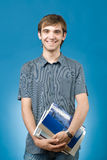 Happy young man with books Royalty Free Stock Photos