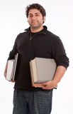 Happy young man with books Royalty Free Stock Images