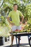 Happy Young Man At Botanical Garden Royalty Free Stock Photos