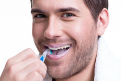 Happy young man brushing teeth. Stock Photo