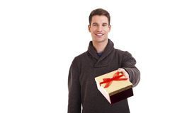 Happy young man carries present Stock Images