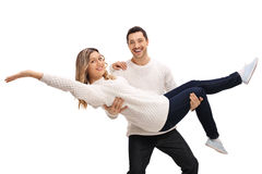 Happy young man carrying a young woman in his arms Royalty Free Stock Photo