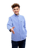 Happy young man in casual clothes standing Stock Photos