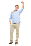 Happy young man celebrating with arms up isolated on white backg Royalty Free Stock Image