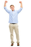 Happy young man celebrating with arms up isolated on white backg Royalty Free Stock Photos
