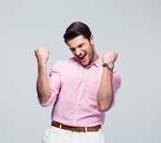 Happy young man celebrating his success Royalty Free Stock Images