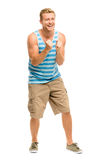 Happy young man celebrating success on white background Stock Photos