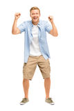 Happy young man celebrating success on white background Stock Image