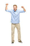 Happy young man celebrating success on white background Royalty Free Stock Image