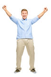 Happy young man celebrating success on white background Stock Photography