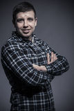 Happy young man in checked shirt Stock Image
