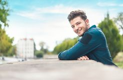 Happy young man in the city, shallow dof stock image