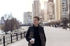 Happy young man on a city street Stock Photo