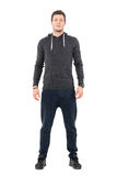 Happy young man in comfortable casual sportswear smiling and looking at camera. Royalty Free Stock Photo