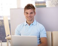 Happy young man with computer Stock Photo