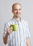 Happy young man with cup of coffee Royalty Free Stock Photo