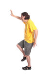 Happy young man dancing. Isolated on white stock photography