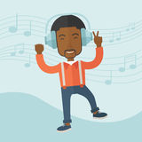 Happy young man dancing while listening to music Stock Image