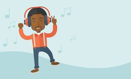 Happy young man dancing while listening to music Stock Photos